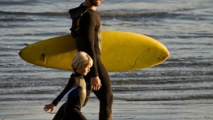 Father taking son surfing