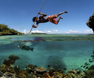 Spear Fishing off Rock